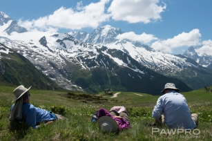 TMB hikers resting with Mont Blanc in the distance